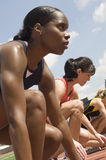 Female Athletes Ready To Race On Track stock images