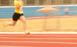 Female athletes running on the track Royalty Free Stock Photos