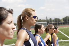 Female Athletes Standing In Line On Field Royalty Free Stock Photo