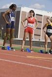 Female Athletes At Starting Blocks Stock Images