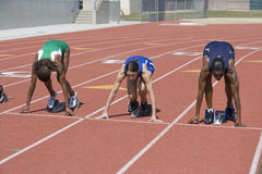 Female Athletes At Starting Line On Race Track Royalty Free Stock Photography