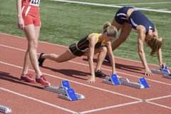 Female Athletes Warming Up At Starting Line Stock Photos