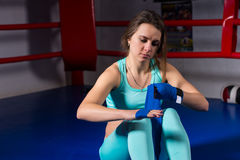 Female athletic boxer preparing bandages for fight Royalty Free Stock Photos