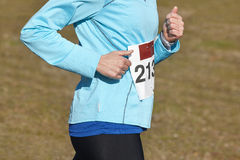 Female athletic runner on a cross country race. Outdoor circuit Stock Images