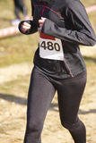 Female athletic runner on a cross country race. Outdoor circuit Royalty Free Stock Images