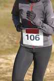 Female athletic runner on a cross country race. Outdoor circuit Stock Image