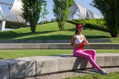 Fit young woman resting after training in park Royalty Free Stock Image