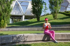 Fit young woman resting after training in park Stock Photography