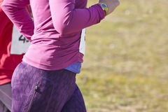 Female athletic runners on a cross country race. Outdoor circuit Stock Photography