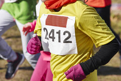 Female athletic runners on a cross country race. Outdoor circuit Stock Images