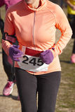 Female athletic runners on a cross country race. Outdoor circuit Stock Photo