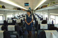 Female attendant in train, China stock photography