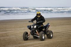Female ATV riding on the beach Stock Image