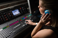 Female audio engineer using sound mixer Royalty Free Stock Photography