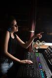 Female audio engineer using sound mixer Stock Photo