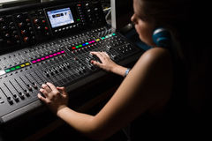 Female audio engineer using sound mixer Royalty Free Stock Image