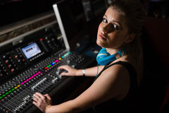 Female audio engineer using sound mixer Stock Image