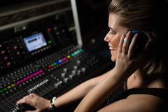 Female audio engineer using sound mixer Stock Images