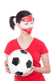 Female austria soccer fan with ball Royalty Free Stock Photo