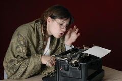 Female author typing on an old typewriter Royalty Free Stock Photos