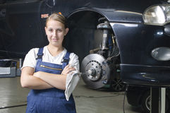 Female auto mechanic is satisfied Stock Photography