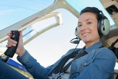 Female aviator in cockpit Stock Photos