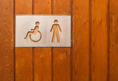 Female, baby changing and handicap toilet sign Stock Photo
