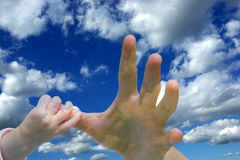 Female and baby hand on sky background Royalty Free Stock Images