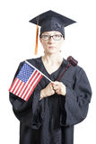 Female bachelor with eyeglasses holding american flag and judge Royalty Free Stock Photos