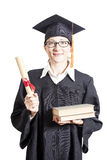 Female bachelor with eyeglasses in mantle holding books and dipl Stock Image