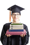 Female bachelor with eyeglasses in mantle holding books Stock Photo