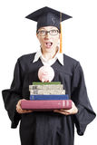 Female bachelor with eyeglasses in mantle holding books and pigg Royalty Free Stock Photos
