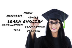 Female bachelor writes english materials Royalty Free Stock Photo