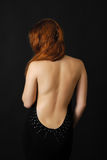 Female back in the dark Royalty Free Stock Photo