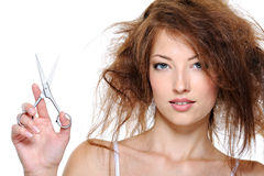 Female with backcombing hair and with scissors Royalty Free Stock Photos