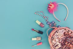 Female backpack with cosmetics and women`s accessories Royalty Free Stock Photography