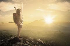 Female backpacker enjoying freedom at mountain Royalty Free Stock Photo