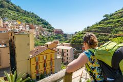 Female backpacker enjoying view of picturesque medieval town. royalty free stock images