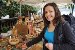 Female backpacker enjoys market. Young female backpacker enjoys exploring a local arts and crafts market. Switzerland Stock Photos