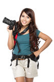 Female backpacker going on vacation with backpack and camera Royalty Free Stock Photo