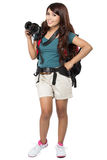 Female backpacker going on vacation with backpack and camera Royalty Free Stock Images