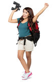 Female backpacker going on vacation with backpack and camera Stock Photos