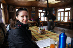 Female backpacker in high altitude guest house Stock Image