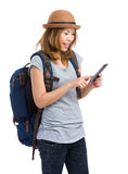 Female backpacker look at mobile phone. Isolated on white Stock Photo