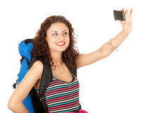Female backpacker with photo camera Royalty Free Stock Image