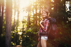Female backpacker set out on forest trail Stock Photo