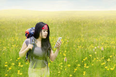 Female backpacker with smartphone in nature Stock Photos