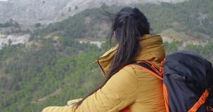 Female backpacker taking a rest stock footage