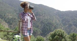 Female backpacker in VR glasses stock footage