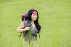 Female backpacker walk in nature Stock Images